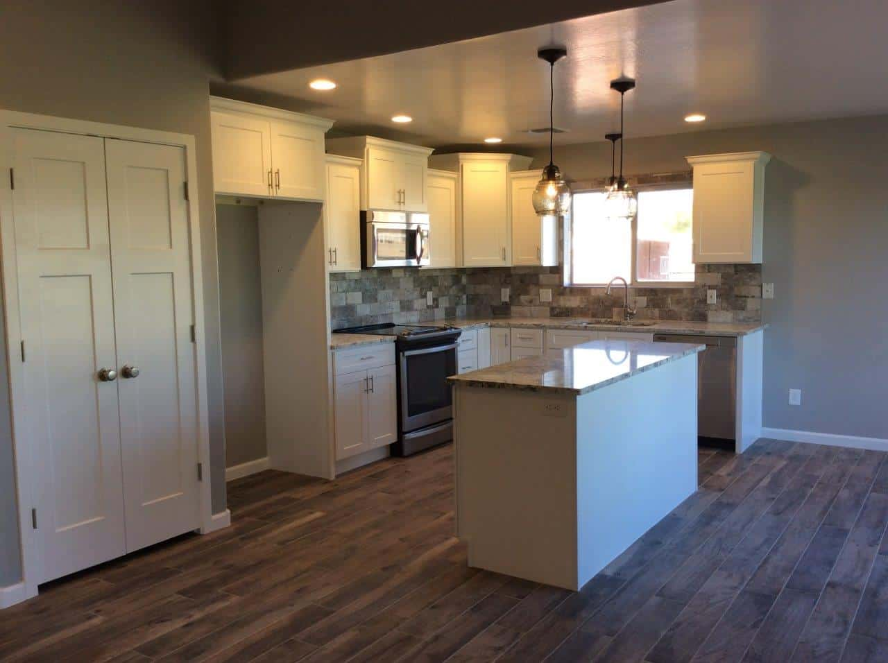 Newly painted kitchen with glossy island