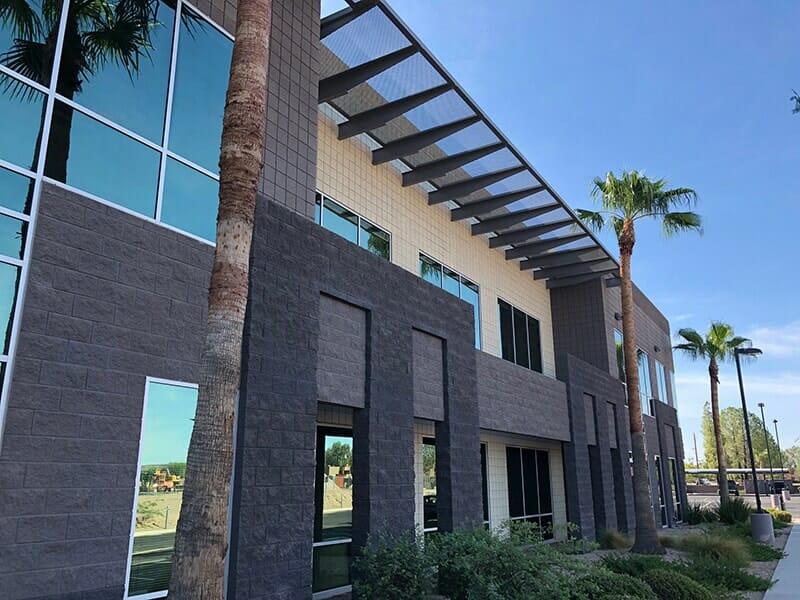 side view of newly painted commercial office building in phoenix area