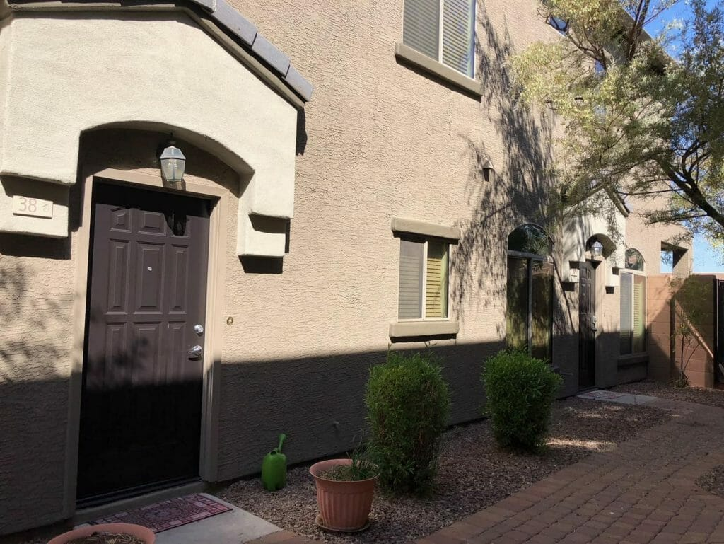 Duplex with fresh paint near front doors with sidewalk